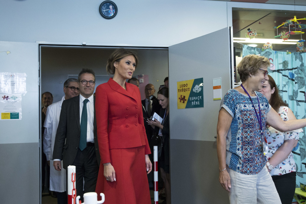 Mandatory Credit: Photo by AP/REX/Shutterstock (8959583f) First Lady Melania Trump, center, visits the Necker hospital, France's biggest pediatric hospital in Paris, . Melania Trump is touring the hospital shortly after her arrival in France with President Donald Trump aboard Air Force One Trump, Paris, France - 13 Jul 2017