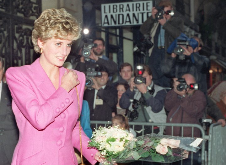 PARIS, FRANCE - NOVEMBER 14: Picture dated 14 November 1992 of Princess Diana leaving the first anti-AIDS bookshop in Paris. Diana, Princess of Wales died in hospital early 31 August after a midnight car crash in central Paris in which her friend the Egyptian millionaire film-producer Dodi al-Fayed and driver were also killed. At the time of the crash, the car was being pursued by paparazzi press photographers on motorcycles. (Photo credit should read VINCENT AMALVY/AFP/Getty Images)