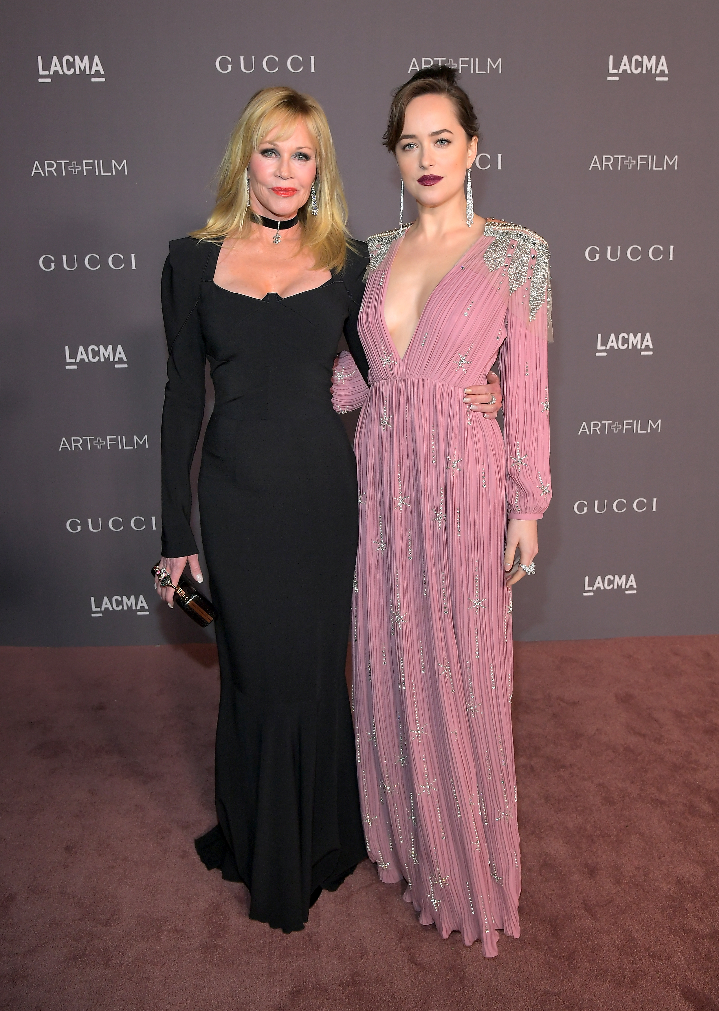 LOS ANGELES, CA - NOVEMBER 04: Actors Melanie Griffith (L) and Dakota Johnson, wearing Gucci, attend the 2017 LACMA Art + Film Gala Honoring Mark Bradford And George Lucas at LACMA on November 4, 2017 in Los Angeles, California. (Photo by Charley Gallay/Getty Images for LACMA)