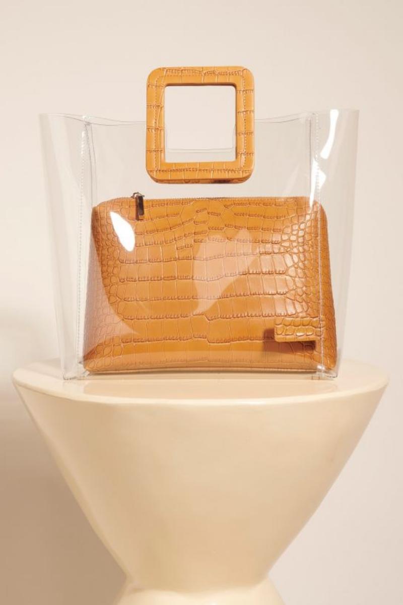Túi nhựa của Staud đi kèm một ví giả da cá sấu có giá 210 đôla, không quá đắt đúng không?