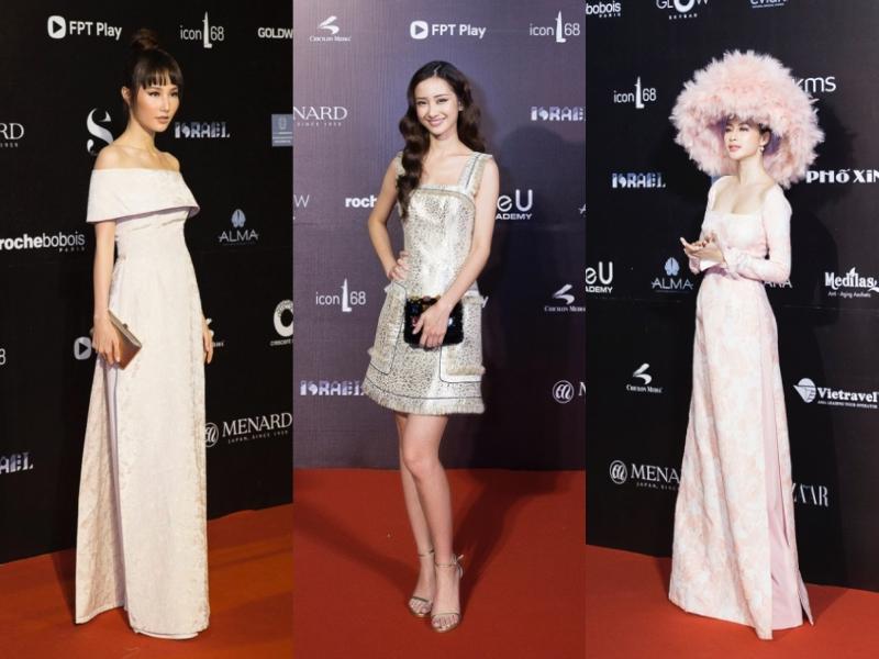 Diễm My 9X (trái) chọn một thiết kế áo dài cách điệu sang trọng; Jun Vũ (giữa) mặc thiết kế đầm ngắn trẻ trung; Angela Phương Trinh tiếp tục khiến mọi người xôn xao và tò mò với lựa chọn trang phục của mình.