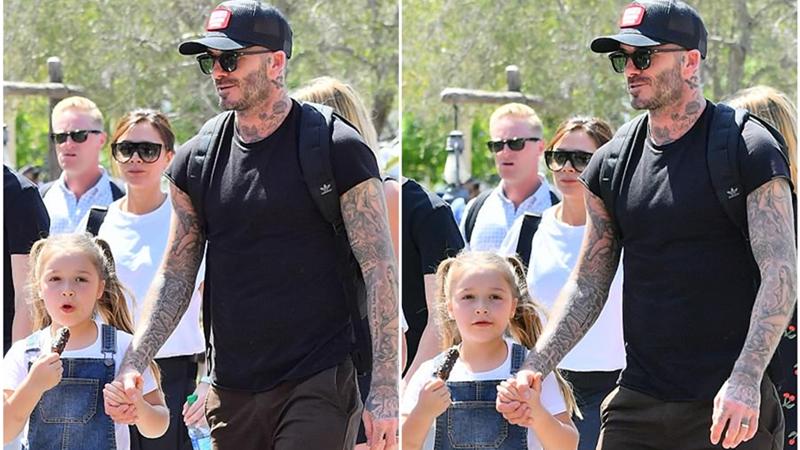"""""""Công chúa nhỏ"""" Harper nắm chặt tay bố không rời khi đi dạo Disneyland"""