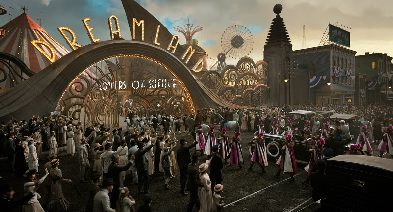 """DREAMING BIG -- In Tim Burton's all-new, live-action reimagining of """"Dumbo,"""" persuasive entrepreneur V.A. Vandevere (Michael Keaton) decides that a young elephant from a struggling circus belongs in his newest, larger-than-life entertainment venture, Dreamland. Directed by Burton and produced by Katterli Frauenfelder, Derek Frey, Ehren Kruger and Justin Springer, """"Dumbo"""" flies into theaters on March 29, 2019. © 2018 Disney Enterprises, Inc. All Rights Reserved."""