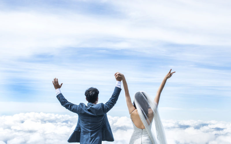 Pic by Keow Wee Loong/Caters News - (Pictured: Newly weds Wayne Huang and Amanda Tsao from Taiwan seem to be holding hands in heaven atop Mt.Kinabalu in Sabah, Malaysia.) - A couple on cloud nine in love braved freezing temperatures and a three day hike for a stunning wedding shoot. Photographer, Keow Wee Loong was asked by a couple in Taiwan to take the most extreme wedding photos ever and they could not have been happier with the results. Wayne Huang and Amanda Tsao contacted Keow with an idea to have their wedding photos taken on mount Rinjani, Indonesia and Kinabalu, Malaysia. SEE CATERS COPY.