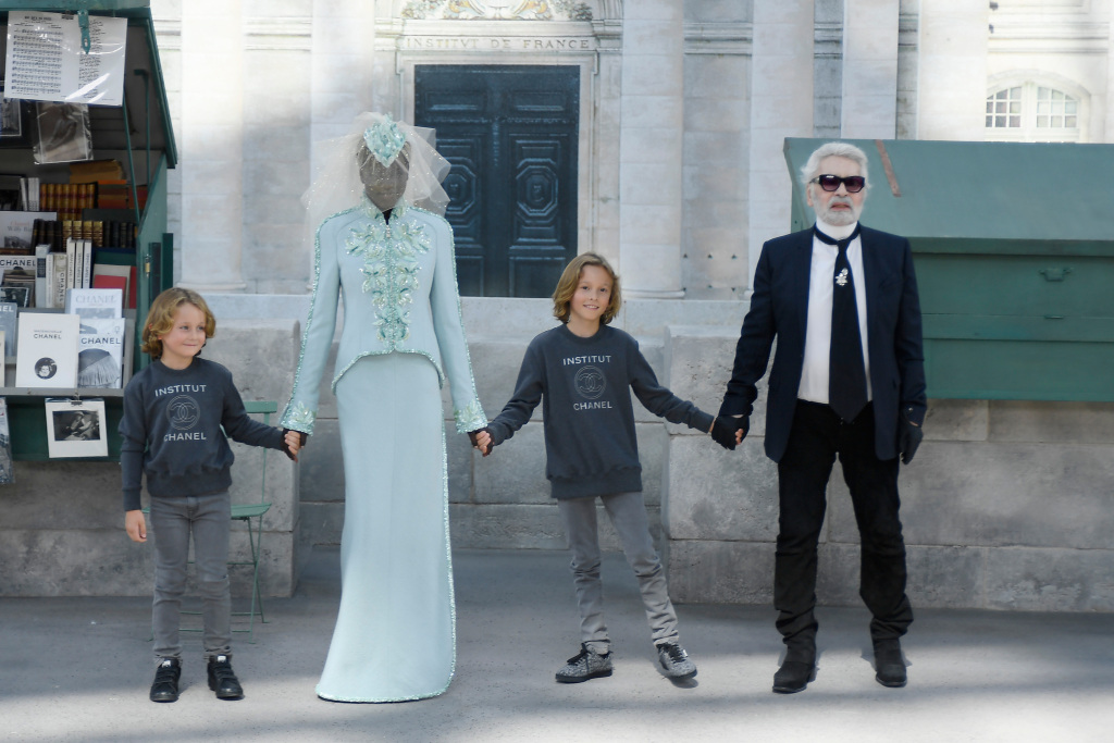 Mandatory Credit: Photo by WWD/REX/Shutterstock (9731905c) Karl Lagerfeld, Hudson Kroenig and Adut Akech on the catwalk Chanel show, Runway, Fall Winter 2018, Haute Couture Fashion Week, Paris, France - 03 Jul 2018