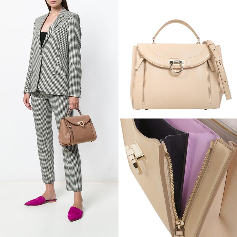 Chiếc túi xách mà thư ký Kim lựa chọn cho set đồ trên là túi xách Sofia Rainbow của Salvatore Ferragamo. Túi có nhiều ngăn với phần lót da bên trong mang màu sắc đối lập với da bên ngoài, tạo điểm nhấn độc đáo. Túi có giá khoảng từ 46 triệu đồng, tùy theo kích thước, chất liệu da.