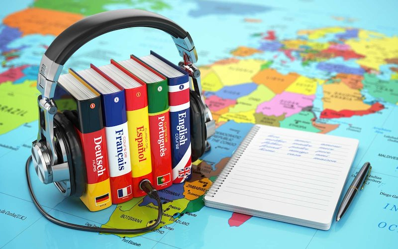 Learning languages online. Audiobooks concept. Books and headpho