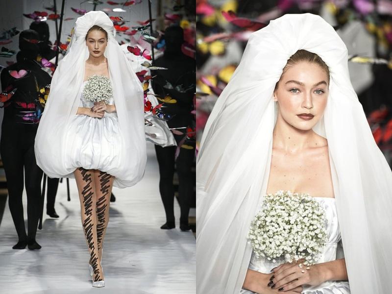 Gigi Hadid diện thiết kế váy bồng, đội mạn che đầu như một cô dâu.