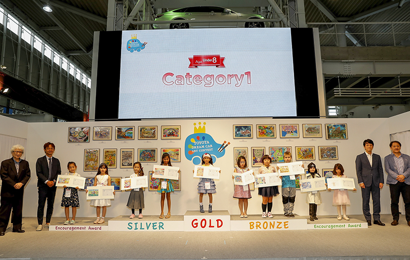 TOKYO, JAPAN - AUGUST 29: Winners and juries of age 7 and under category line up for photos during the 12th Toyota Dream Car Art Contest Award Ceremony on August 29, 2018 in Tokyo, Japan. (Photo by Ken Ishii/Getty Images for TOYOTA MOTOR CORPORATION)