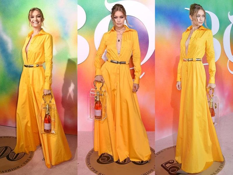 Tại đêm gala kỉ niệm BoF500 của tờ Business of Fashion, Gigi Hadid xuất hiện rực rỡ trên thảm đỏ với thiết kế váy vàng, xẻ ngực sâu và túi xách trong suốt.