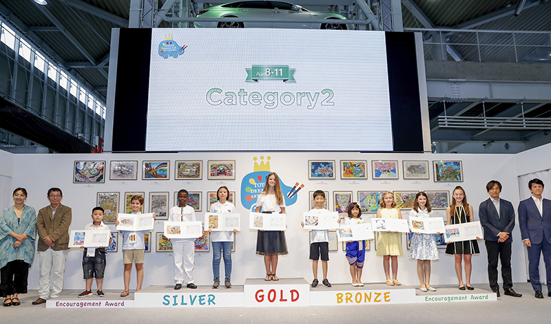 TOKYO, JAPAN - AUGUST 29: Winners and juries of ages 8 to 11 category line up for photos during the 12th Toyota Dream Car Art Contest Award Ceremony on August 29, 2018 in Tokyo, Japan. (Photo by Ken Ishii/Getty Images for TOYOTA MOTOR CORPORATION)