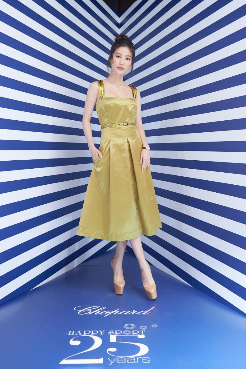 Diễm My 9X diện đầm satin của Bottega Veneta cùng trang sức và đồng hồ của Chopard.