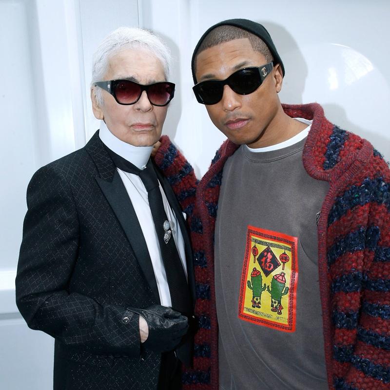 """Trước đó, Pharrell Williams và Giám đốc Sáng tạo của Chanel - ông Karl Lagerfeld cũng từng hợp tác trong nhiều chiến dịch quảng bá trước đó. Chàng nghệ sĩ tài năng này còn từng đích thân viết một ca khúc cho phim ngắn """"Reincarnation"""" do Karl Lagerfeld làm đạo diễn."""
