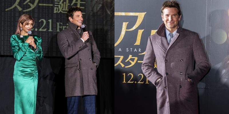 """Ban đầu, Bradley Cooper vẫn """"cool ngầu"""" với chiếc áo khoác bên ngoài bộ suit. Đồng hành tại sự kiện còn có nữ người mẫu Nhật Bản - Rola."""