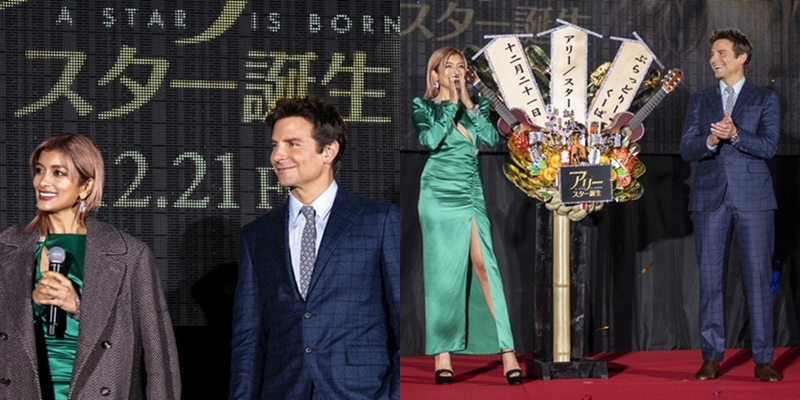 """Được biết, Bradley Cooper đã nhường chiếc áo khoác của mình cho người mẫu Rola. Tuy nhiên, hành động ga-lăng này của anh đã """"phản chủ"""" khi để lộ ra lỗi trang phục mà không quý ông nào muốn mắc phải."""