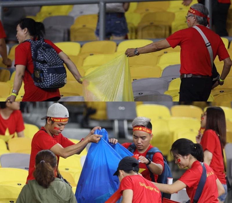 Sau trận tuyển Việt Nam hòa 2-2 trước chủ nhà Malaysia vào tối 11/12, nhiều cổ động viên áo đỏ đã nán lại sân Bukit Jalil dọn dẹp rác.