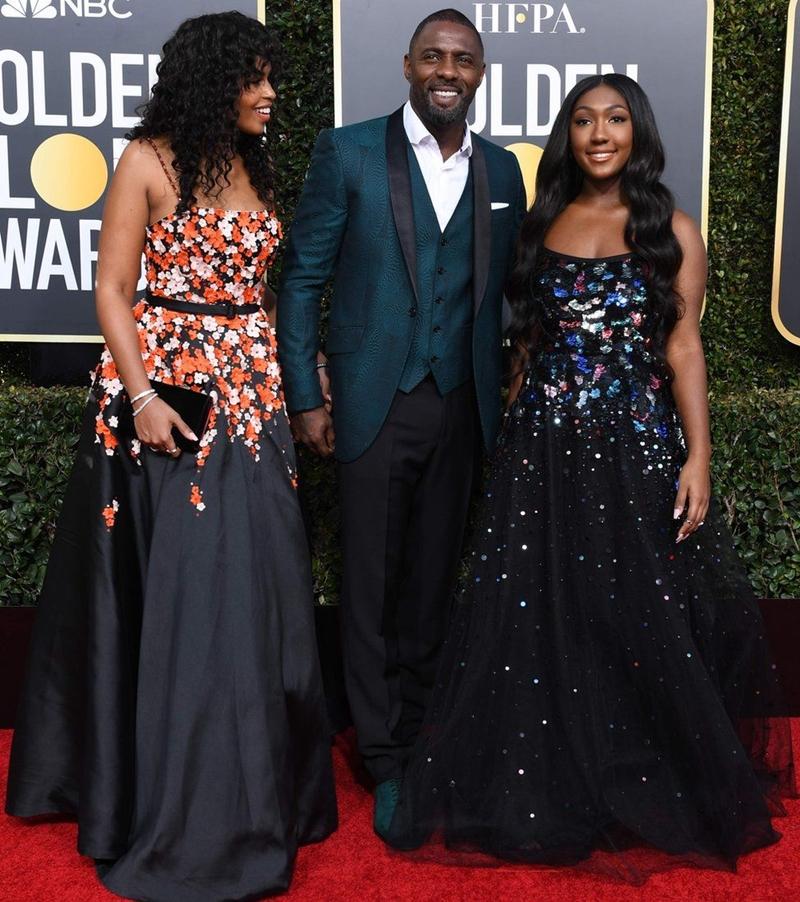 Ứng cử viên cho hình tượng James Bond thế hệ mới - nam diễn viên Idris Elba dự Quả Cầu Vàng 2019 cùng con gái Isan (phải) và hôn thê Sabrina Dhowre (trái).