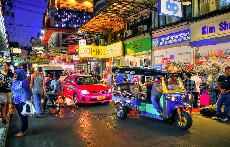 Tuk Tuk and Taxi at the Night MArket in Pratunam Bangkok Thailand