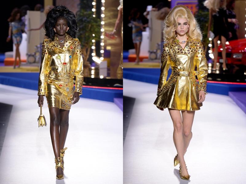 Nối tiếp đó là các thiết kế sắc vàng ánh kim - chất liệu được Moschino tích cực lăng xê trong thời gian gần đây. Loạt chi tiết nhấn nhá trên các bộ váy này là phần đá mô phỏng ngọc ruby, ngọc lục bảo, ngọc bích. đá topaz,... không khác gì đôi găng tay quyền lực của Thanos.